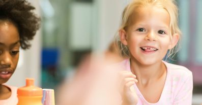 Girl missing front tooth in class