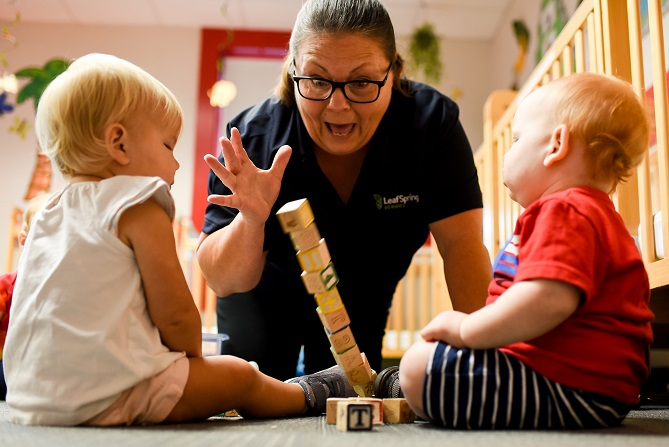Teacher Playing with Blocks with Infants